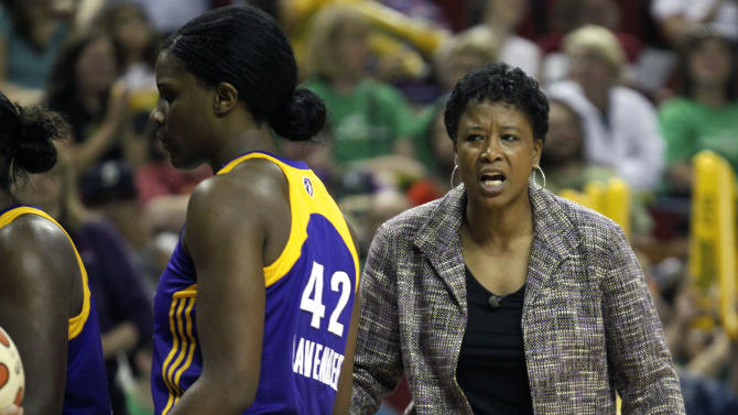 Los Angeles Sparks head coach Jennifer Gillom, right, looks on as Sparks' Jantel Lavender (42) leaves the court during a WNBA basketball game against the Seattle Storm, Saturday, July 9, 2011, in Seattle. The Storm beat the Sparks, 99-80. (AP Photo/Ted S. Warren)