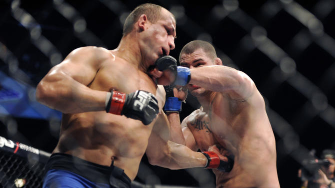 Junior dos Santos of Brazil, left, and Cain Velasquez of San Jose connect with each other during their UFC 155 heavyweight championship mixed martial arts match at the MGM Grand Garden Arena Saturday, Dec, 29, 2012 in Las  Vegas. Velasquez won with a unanimous decision. (AP Photo/David Becker)