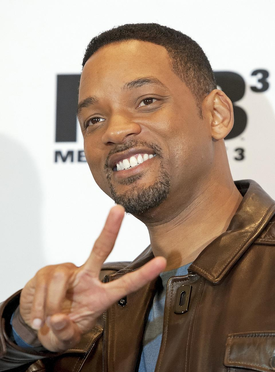 "US actor Will Smith poses as he arrives for a photocall ahead of the German Premiere of ""Men in Black 3"" in Berlin, Monday, May 14, 2012. (AP Photo/Jens Meyer)"