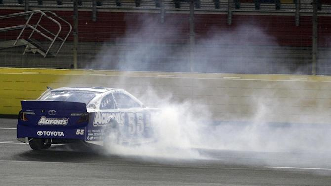 Mark Martin spins on the front stretch during the NASCAR All-Star auto race at Charlotte Motor Speedway in Concord, N.C., Saturday, May 18, 2013. (AP Photo/Nell Redmond)