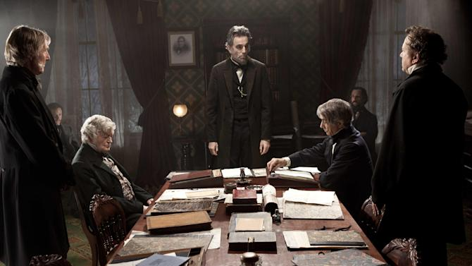 """FILE - This undated publicity photo provided by DreamWorks and Twentieth Century Fox shows Daniel Day-Lewis, center, as Abraham Lincoln in a scene from the film """"Lincoln."""" The film was nominated Thursday, Jan. 10, 2013 for 12 Academy Awards, including best picture, director for Steven Spielberg and acting honors for Daniel Day-Lewis, Sally Field and Tommy Lee Jones. (AP Photo/DreamWorks, Twentieth Century Fox, David James, File)"""