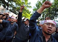 Demonstrators protest against Myanmar's treatment of Muslim Rohingya outside the Myanmar embassy in Jakarta. Around 100 men called for the ambassador to be expelled