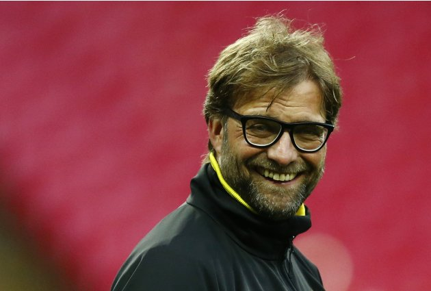 Borussia Dortmund's coach Klopp smiles during a training session at Wembley Stadium in London