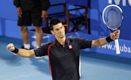 Serbia's Novak Djokovic celebrates winning the Mubadala World Tennis Championship final against Spain's Nicolas Almagro in Abu Dhabi on December 29, 2012. Djokovic got his season off to a perfect start by defeating Almagro 6-7 (4/7), 6-3, 6-4