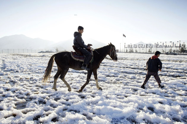 "In this Wednesday, Feb. 6, 2013 photo, Afghan actor Fawad Mohammadi 14, rides a horse on Nader Khan's hill at the one of the areas where a part of the Afghani Oscar Nominee film titled ""Buzkashi Boys,"" shot in Kabul, Afghanistan. Fawad Mohammadi has spent half his life peddling maps and dictionaries to foreigners in the main tourist district in Kabul. Now the 14-year-old Afghan boy with beautiful green eyes is getting ready for his first airplane ride and a trip down the red carpet at the Oscars. (AP Photo/Musadeq Sadeq)"
