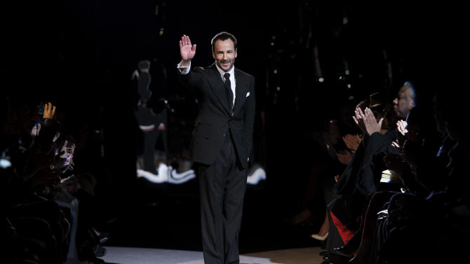 U.S fashion designer Tom Ford waves during his show at  London Fashion Week, Monday, Feb. 18, 2013, London. (Photo by Jonathan Short/Invision/AP)