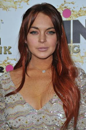 Lindsay Lohan attends the Mr. Pink Ginseng launch party at the Beverly Wilshire hotel on Thursday, Oct. 11, 2012, in Beverly Hills, Calif. (Photo by Richard Shotwell/Invision/AP)