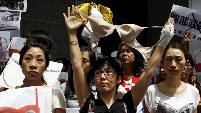 Protesters wear bras over their shirts during a demonstration in support of Hong Kong female protester Ng Lai-ying, outside the police headquarters in Hong Kong