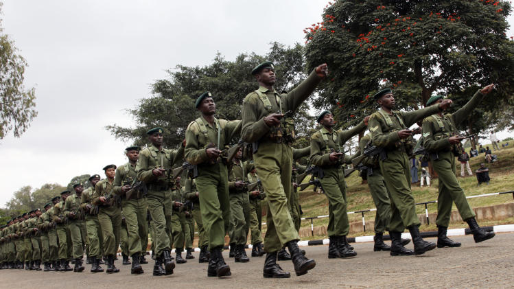 FILE - In this Tuesday, Aug. 24, 2010 file photo, Kenya Army soldiers rehearse a military parade at Uhuru Park, in Nairobi, Kenya. Kenyan military forces moved into southern Somalia on Sunday, an official and residents said, a day after top Kenyan defence officials said the country has the right to defend itself after a rash of militant kidnappings of Europeans inside Kenya. (AP Photo/Sayyid Azim, File)