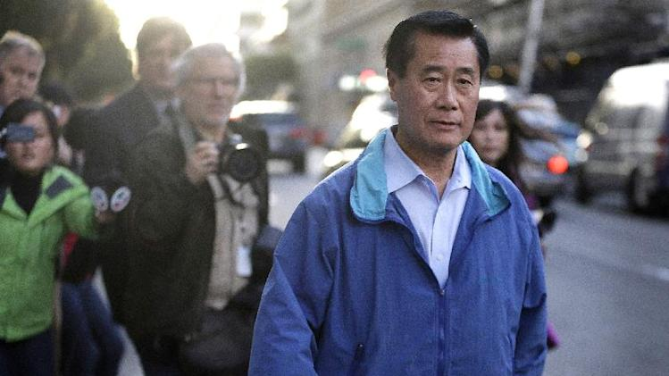 "FILE - In this Wednesday, March 26, 2014 file photo, California state Sen. Leland Yee, D-San Francisco, right, leaves the San Francisco Federal Building in San Francisco. So far in 2014, each month has brought news of another arrest or conviction of a Democratic California state senator. The latest was Wednesday's arrest of Yee, on federal corruption charges, news that roiled the capital and led one of Yee's opponents in the race for secretary of state to call the Legislature a ""corrupt institution."" (AP Photo/Ben Margot,File)"
