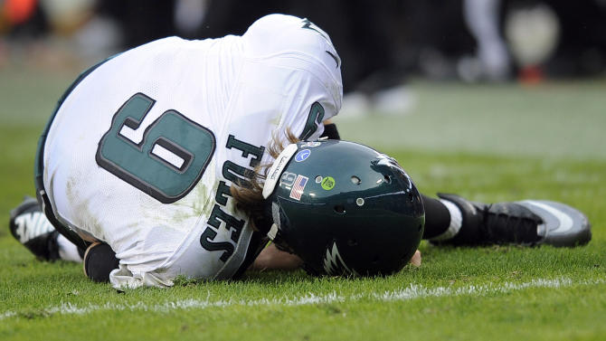 Philadelphia Eagles quarterback Nick Foles lies on the the turf after a tackle during the second half of an NFL football game against the Washington Redskins in Landover, Md., Sunday, Nov. 18, 2012. The Redskins won 31-6. (AP Photo/Nick Wass)