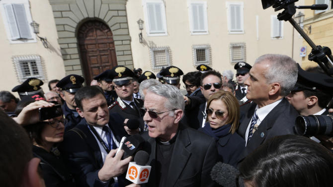 "Vatican spokesman Rev. Federico Lombardi meets journalists outside the papal residence in Castel Gandolfo, Saturday March 23, 2013. Pope Francis traveled Saturday to this hilltown south of Rome to have lunch with his ""brother"" and predecessor Benedict XVI, an historic and potentially problematic melding of the papacies that has never before confronted the Catholic Church. The two men in white embraced warmly on the helipad in the gardens of Castel Gandolfo, where Benedict has been living since he retired Feb. 28 and became the first pope to resign in 600 years. (AP Photo/Alessandra Tarantino)"
