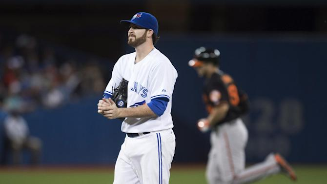 Toronto Blue Jays starting pitcher Drew Hutchison, left, reacts as Baltimore Orioles' Chris Davis rounds the bases after his two-run home run during the sixth inning of a baseball game Friday, Sept. 4, 2015, in Toronto. (Darren Calabrese/The Canadian Press via AP)