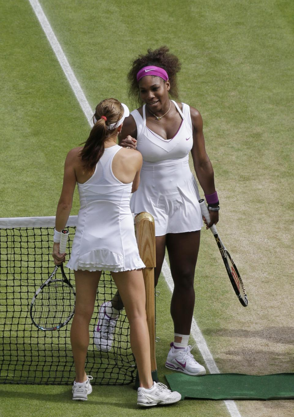 Serena Williams of the United States, right, is congratulated by Agnieszka Radwanska of Poland after winning the women's final match at the All England Lawn Tennis Championships at Wimbledon, England, Saturday, July 7, 2012. (AP Photo/Anja Niedringhaus, Pool)