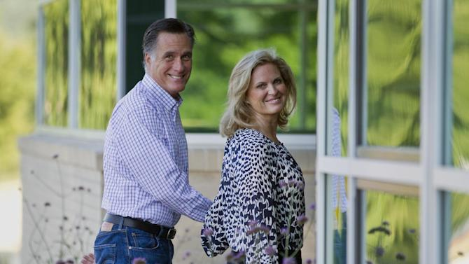 "Republican presidential candidate, former Massachusetts Gov. Mitt Romney and his wife Ann, arrive at Brewster Academy, for convention preparations in Wolfeboro, N.H., Aug. 27, 2012. The Romneys envision a White House enlivened by ""little feet in the hallway"", 18 visiting grandkids and they are dishing out personal details as they try to warm up a candidate burdened by a cold-fish image. America may not be ready for this one: Instead of syrup, Mitt Romney slathers his pancakes with peanut butter. (AP Photo/Evan Vucci, File)"