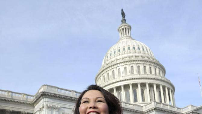Rep.-elect Tammy Duckworth, D-Ill. is seen on Capitol Hill in Washington, Thursday, Jan. 3, 2013, as she poses with other female House members prior to the official opening of the 113th Congress. (AP Photo/Cliff Owen)