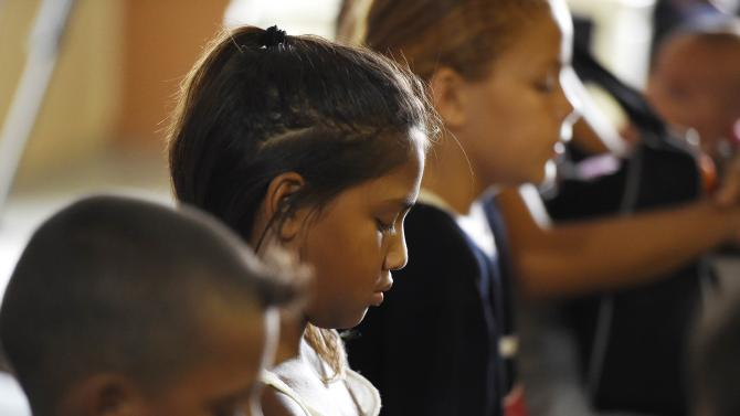 Children attend church service for eight children who were killed in the Cairns suburb of Manoora