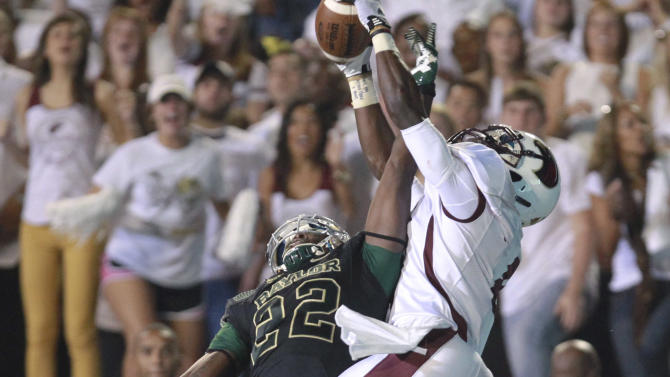 Baylor defender Joe Williams, left, knocks away a pass intended for Louisiana-Monroe receiver Tavarese Maye during the first half of an NCAA college football game, Friday, Sept. 21, 2012, in Monroe, La. (AP Photo/Waco Tribune Herald, Duane A. Laverty)