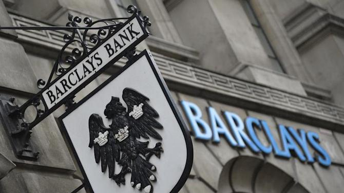 Logos are seen outside a branch of Barclays bank in London