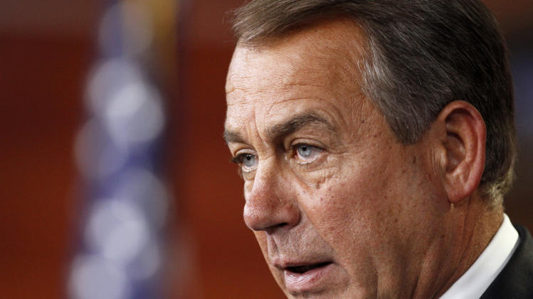 Boehner protests Obama veto threats on budget