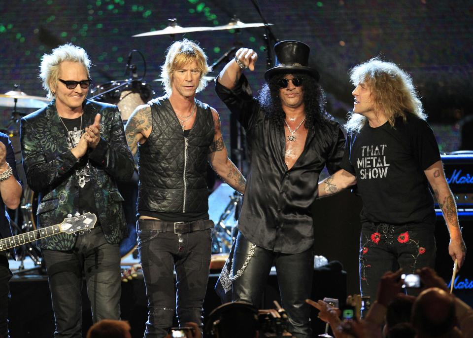 Guns N' Roses, from left: Matt Sorum, Duff McKagan, Slash and Steven Adler, after their performance following induction into the Rock and Roll Hall of Fame Sunday, April 15, 2012, in Cleveland. (AP Photo/Tony Dejak)