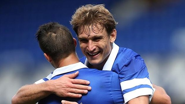 Nikica Jelavic, right, celebrates with Kevin Mirallas (PA)