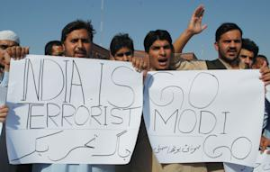 Pakistani protesters hold a rally against India, Friday, …
