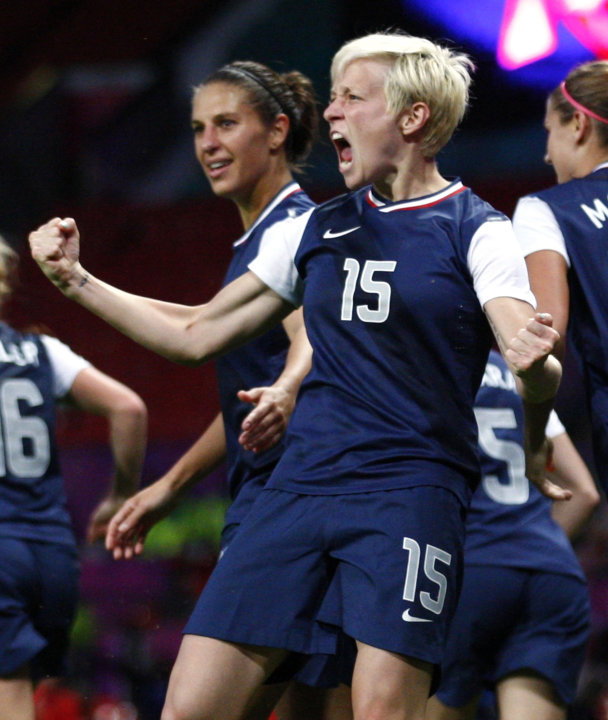 USA's Rapinoe celebrates with teammates after her corner kick went in for a goal against Canada in the women's semi final soccer match at the London 2012 Olympic Games at Old Trafford in Manchester