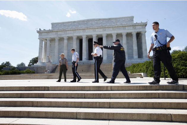 Security keeps people from entering the Lincoln Memorial in Washington, Tuesday, Aug. 23, 2011, after it was evacuated following an earthquake in the Washington area. A 5.9 magnitude earthquake center