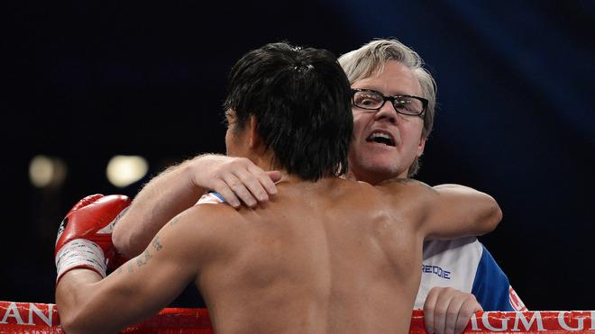 (R-L) Trainer Freddie Roach Gives Getty Images