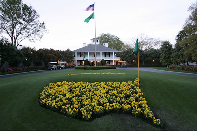 FILE - This April 5, 2006 file photo shows bright yellow flowers in the shape of the United States adorn the lawn at the clubhouse during practice for the 2006 Masters golf tournament at the Augusta N