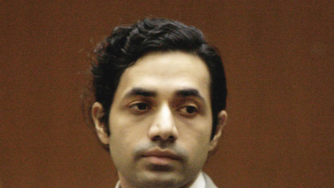 In this Nov. 13, 2008 file photo, fashion designer Anand Jon Alexander appears at his sexual assault trial in Los Angeles. Alexander, already serving 59 years to life in California for molesting would-be models, was sentenced in New York, on Tuesday, April 2, 2013, to five years in a similar case in a courtroom full of his supporters who blew him kisses. Alexander was once a burgeoning fashion designer on the brink of fame and fortune, living a fast life of women, celebrities and travel, until allegations surfaced that he had raped aspiring models. The 38-year-old says from his jail cell that he believes new evidence will help overturn his conviction on charges he sexually assaulted women, and his sentence of 59 years to life. (AP Photo/Nick Ut, File)