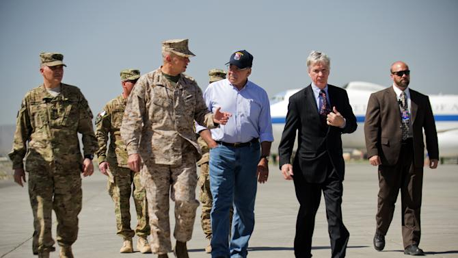 U.S. Defense Secretary Leon Panetta, center right, speaks with U.S. Ambassador to Afghanistan Ryan Crocker, second right, and the head of NATO coalition forces in Afghanistan Gen. John Allen, center left, upon his arrival at Kabul International Airport in Kabul, Afghanistan Thursday, June 7, 2012. Panetta arrived in Afghanistan on Thursday to take stock of progress in the war and discuss plans for the troop drawdown, even as violence spiked in the south. (AP Photo/Jim Watson, Pool)