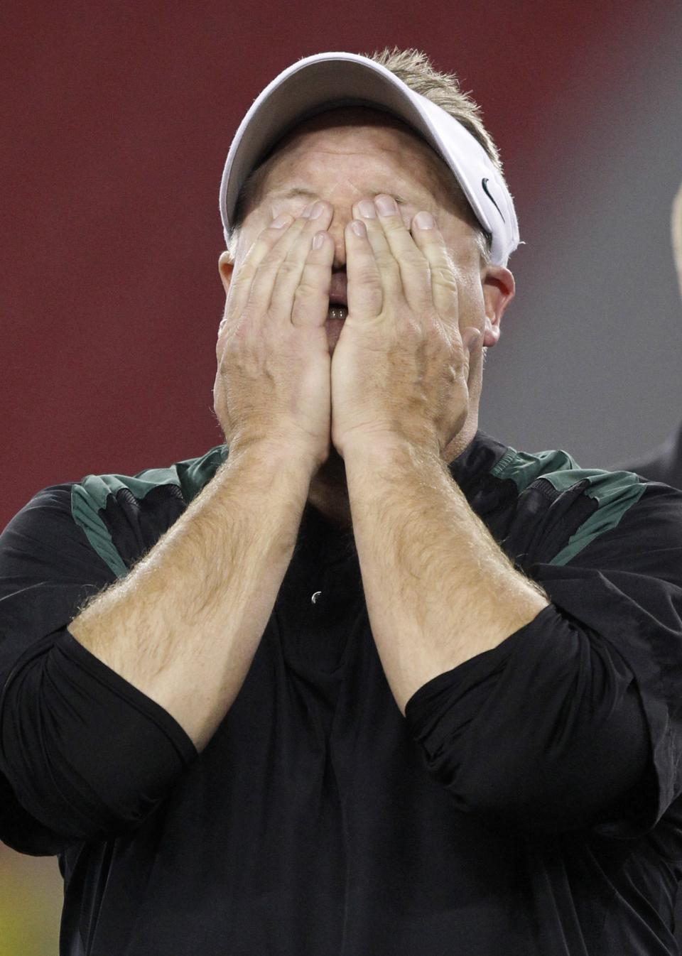 Oregon head coach Chip Kelly wipes his eyes after the Fiesta Bowl NCAA college football game, Thursday, Jan. 3, 2013, in Glendale, Ariz. Oregon defeated Kansas State 35-17.(AP Photo/Paul Connors)