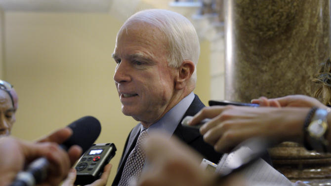 Sen. John McCain, R-Ariz., talks with reporters on Capitol Hill in Washington, Sunday, July 31, 2011, as the debt showdown continues. (AP Photo/Susan Walsh)