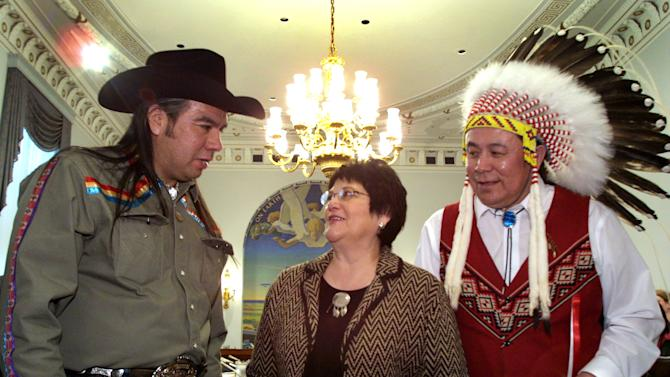 FILE - A Feb. 6, 2002 file photo shows National Congress of American Indians President Tex Hall, left, with Elouise Cobell of the Blackfeet Tribe of Montana, center, and Jimmy Goddard, from the same tribe, on Capitol Hill. Settlement payments among hundreds of thousands of Native Americans whose land-trust royalties were mismanaged by the government for more than a century have been held up by more than 2,400 appeals by people who were ruled ineligible to participate in the settlement. At issue is the second of two distributions in one of the largest U.S. government settlements in history, prompted by a lawsuit filed in 1996 by Cobell. (AP Photo/Terry Ashe, File)