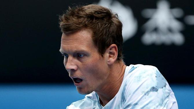 Tomas Berdych of the Czech Republic makes a backhand return to Rafael Nadal of Spain during their quarterfinal match at the Australian Open tennis championship in Melbourne, Australia, Tuesday, Jan. 27, 2015. (AP Photo/Rob Griffith)
