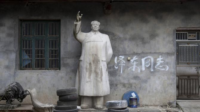 A limestone statue of China's late Chairman Mao Zedong is seen in a yard, in Shaoshan