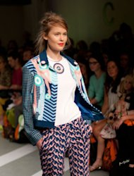 Clashing prints, candy brights and floral embellishments are given a retro update at Holly Fulton…