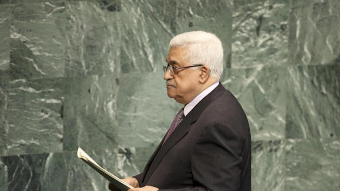 """FILE - Palestinian President Mahmoud Abbas leaves the podium after speaking during the 67th session of the United Nations General Assembly at U.N. headquarters in this Thursday, Sept. 27, 2012 file photo. Palestinian leaders plan to shake up the 19-year-old peace process and proceed with a United Nations statehood bid in November over U.S. objections. The move to upgrade the their status to that of a """"non-member state"""" in the UN General Assembly comes a year after the failed effort to obtain full membership through the Security Council, a step the Obama administration blocked. (AP Photo/Seth Wenig)"""
