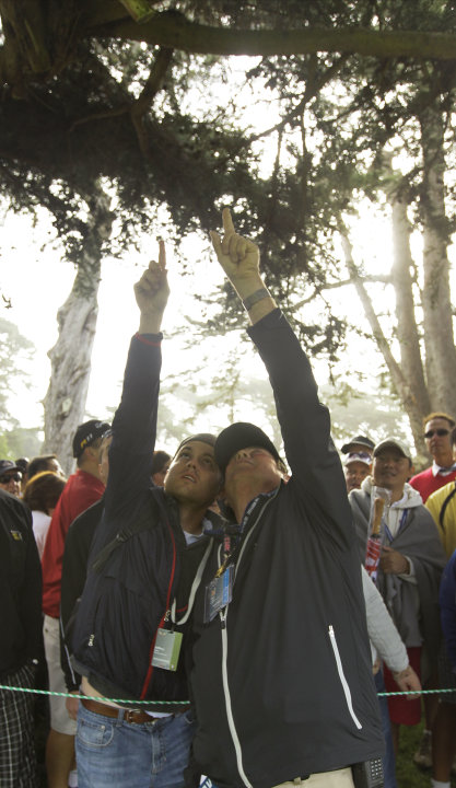 Fans point to a ball thought to be Phil Mickelson's during the first round of the U.S. Open Championship golf tournament Thursday, June 14, 2012, at The Olympic Club in San Francisco. (AP Photo/Eric R