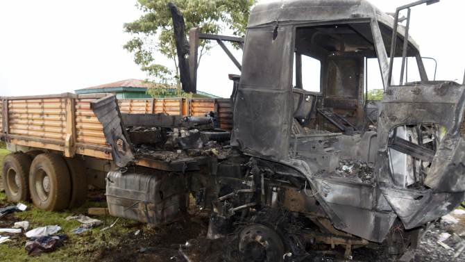 Burnt truck used by M23 rebel fighters is pictured after the rebels surrendered to the Congolese army in Chanzo village in the Rutshuru territory near the eastern town of Goma