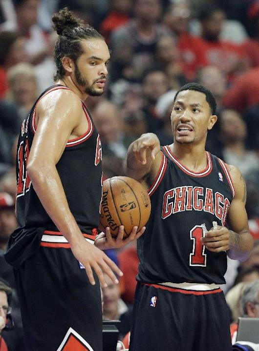 Chicago Bulls guard Derrick Rose, right, talks with center Joakim Noah during the first half of an NBA basketball game against the New York Knicks in Chicago, Thursday, Oct. 31, 2013