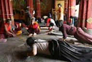 File photo shows Tibetan pilgrims praying at the 1,300-year-old Jokhang Temple in the Tibetan capital Lhasa. Two men set themselves on fire outside the temple on Sunday in protest against Chinese rule