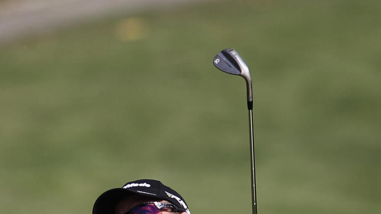 Peter Hanson from Sweden watches a shot at the 11th hole during the first round of the WGC-HSBC Champions golf tournament in Dongguan, southern China's Guangdong province, Thursday Nov. 1, 2012. (AP Photo/Kin Cheung)