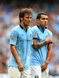 Roberto Mancini says David Silva, left, and Carlos Tevez, right, are not 100 per cent following international action