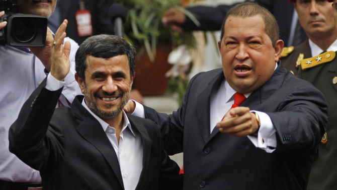 Iran's President Mahmoud Ahmadinejad, left, is received by Venezuela's President Hugo Chavez at the Miraflores presidential palace in Caracas, Venezuela, Monday Jan. 9, 2012. Ahmadinejad visited with Chavez as tensions rose with the U.S. over Tehran's nuclear program and a death sentence against an American man convicted of working for the CIA. Venezuela is the first leg of a four-nation tour that will also take Ahmadinejad to Nicaragua, Cuba and Ecuador. (AP Photo/Ariana Cubillos)
