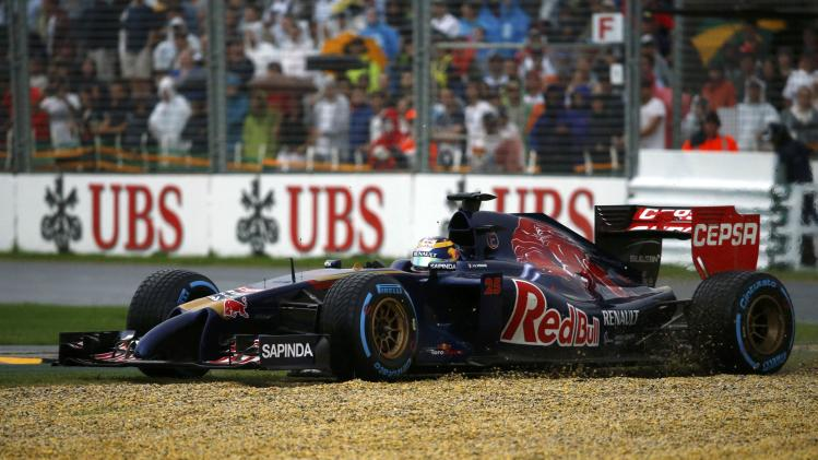 Toro Rosso Formula One driver Vergne of France drives to gravel during the qualifying session for the Australian F1 Grand Prix in Melbourne