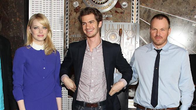 """This Monday, June 25, 2012 file image released by Starpix shows actors  Emma Stone, left, and Andrew Garfield with director Marc Webb from """"The Amazing Spider-Man,"""" at the Empire State Building during a lighting ceremony in New York. Stone, Garfield and Webb replace Kirsten Dunst, Tobey Maguire and director Sam Raimi from the previous films in the hugely popular Spider-man franchise. """"The Amazing Spider-Man"""" opens nationwide on July 3. (AP Photo/Starpix, Amanda Schwab)"""