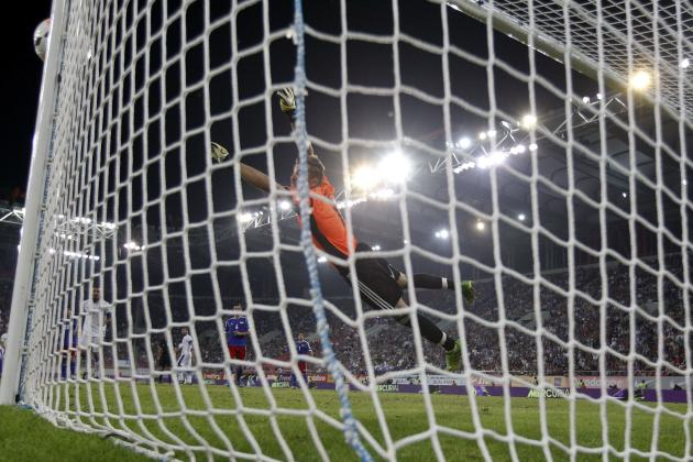 The ball hits the goalpost before going into the net as Liechtenstein's goalkeeper Peter Jehle fails to make a save during a 2014 World Cup qualifying soccer match against Greece at Karaiskaki stadium